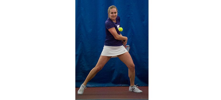 Emily DeShazer | Collegian Junior tennis player Petra Niedermayerova squares up for a backhand on Saturday at Body First Fitness Center. Niedermayerova, who is ranked No. 17 among Division I singles players, is racking up a record number of wins but says her daily performance is more important.