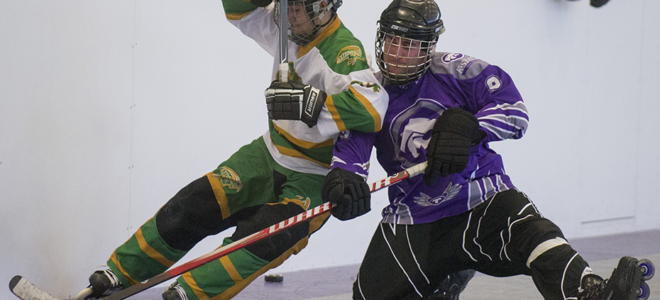 Emily DeShazer | The Collegian Struggling for the puck, senior K-State Inline Hockey Club forward Mike McHugh leans into a Missour S&T player as they roll past on Feb. 9 at the Peters Recreation Complex. The Inline Hockey Club was selected to play in the national tournament on April 14.