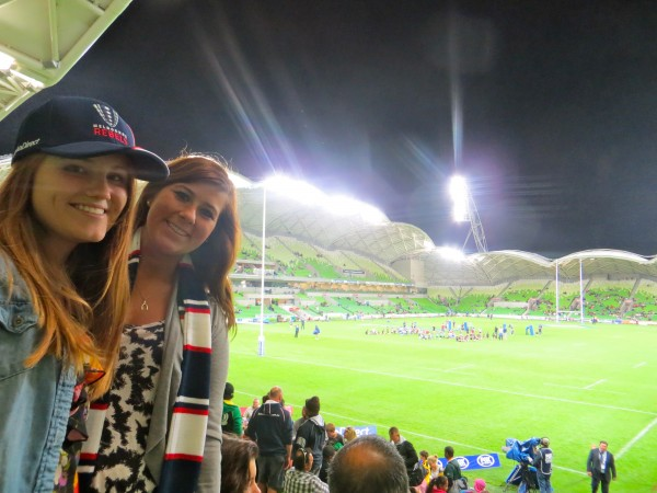 Study abroad student watches Australian game of footy, tastes local cuisine