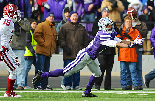Parker Robb | The Collegian  Junior wide receiver Tyler Lockett attempts to haul in a long pass from junior quarterback Jake Waters during the first quarter of the Wildcats' 41-31 loss to the Sooners on senior day November 23, 2013.