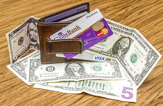 Putting money into your debit account allows you to withdraw your fund as well as make purchases with the card. (Photo Illustration | Mason Swenson)