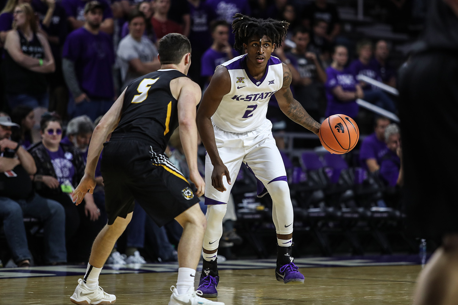 Mawdo Sallah Looks To Pass The Ball During The Mens Basketball Game Between Fort Hays State University And Kansas State University At Bramlage Coliseum In