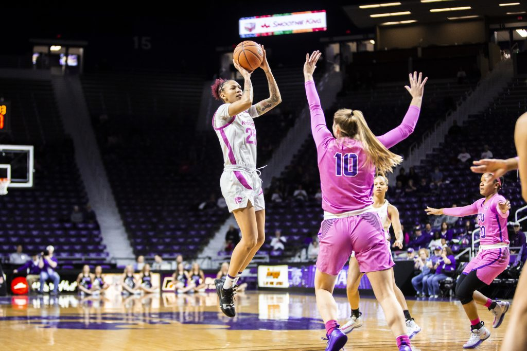 Senior forward Jasauen Beard leaps back for a shot during the women's basketball team's Play 4 Kay Pink Game to promote cancer awareness. K-State played against TCU in Bramlage Coliseum on Feb. 19. The Horned Frogs defeated the Wildcats 54-52. (Logan Wassall | Collegian Media Group)