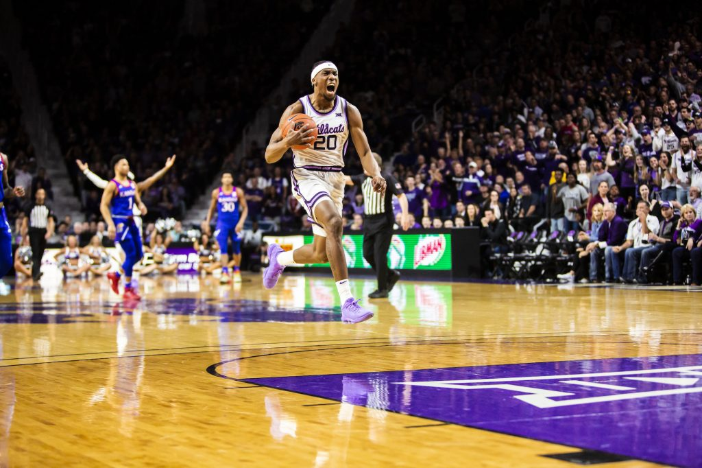 Senior forward Xavier Sneed celebrates after a foul is called during the men's basketball sunflower showdown against Kansas in Bramlage Coliseum on Feb. 29. The Jayhawks narrowly beat the Wildcats 62-58. (Logan Wassall | Collegian Media Group)