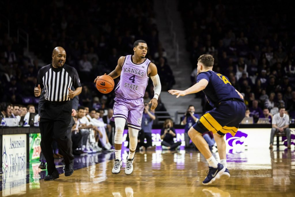Junior guard David Sloan looks across the court for an open play during the men's basketball game against West Virginia in Bramlage Coliseum on Jan. 18, 2020. The Wildcats beat the Mountaineers, 84-68. (Logan Wassall | Collegian Media Group)