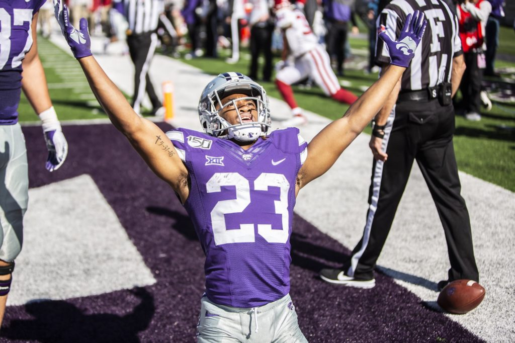 Freshman wide receiver Joshua Youngblood celebrates after running in a touchdown during the homecoming football game against Oklahoma in Bill Snyder Family Stadium on Oct. 26, 2019. The Wildcats upset the No. 5 rated Sooners with a final score of 48-41. (Logan Wassall | Collegian Media Group)