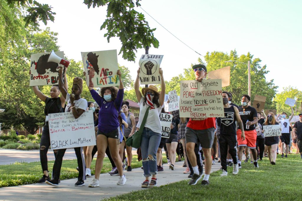 Supporters of the Black Lives Matter movement march in a peaceful protest around City Park on June 3, 2020. (Sarah Unruh | Collegian Media Group)
