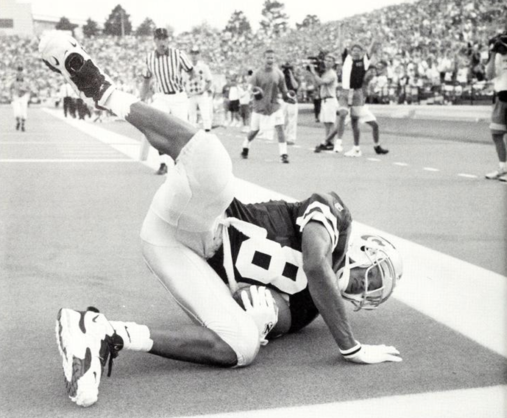 Then-junior wide receiver Kevin Lockett tumbles into the end zone for a touchdown in a 34-7 rout of Temple on Sept. 2, 1995.