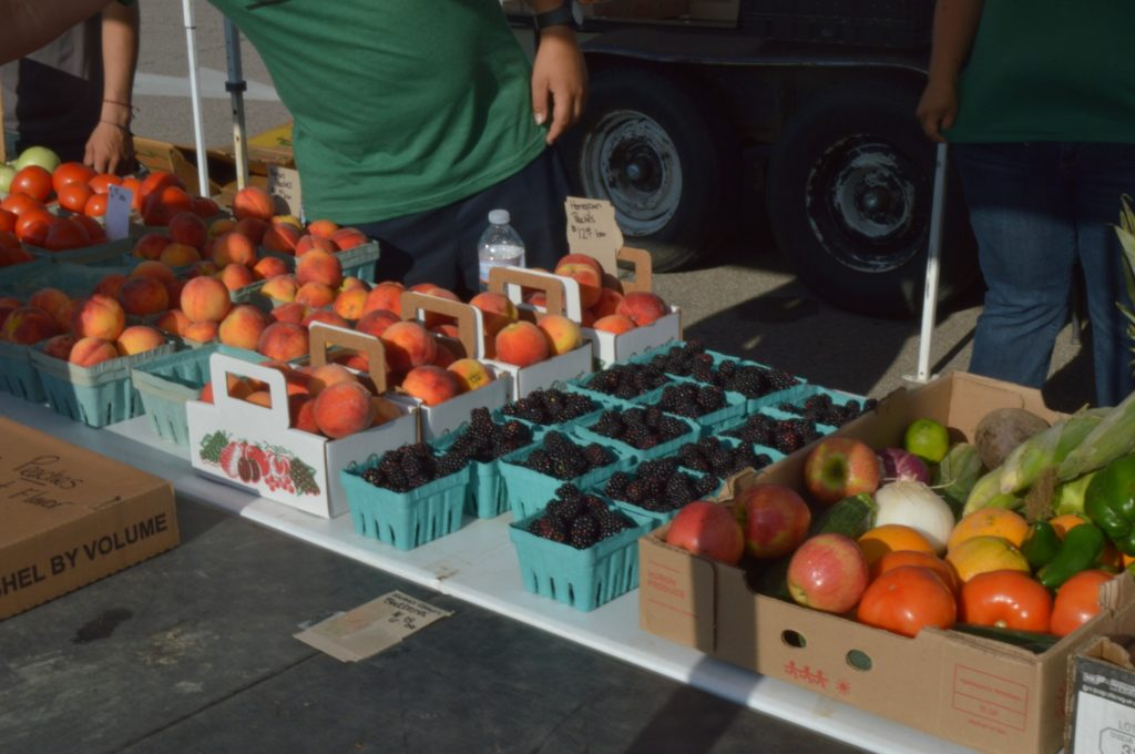 Throughout the COVID-19 pandemic, vendors at the MHK Farmers' Market have continued providing their goods to the community.