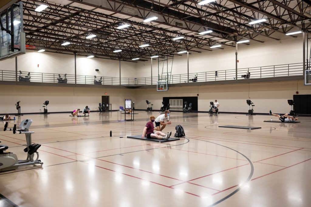Some spaces in the Rec have been converted into other types of spaces to encourage social distancing. For example, the basketball court in the Rec now has stretching zones and some general equipment. (Dylan Connell | Collegian Media Group)