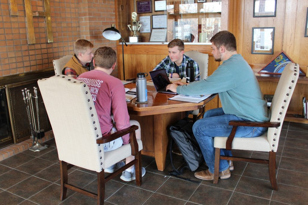 Active members of Farmhouse fraternity studying together in their house. (Emily Eubank | Collegian Media Group)