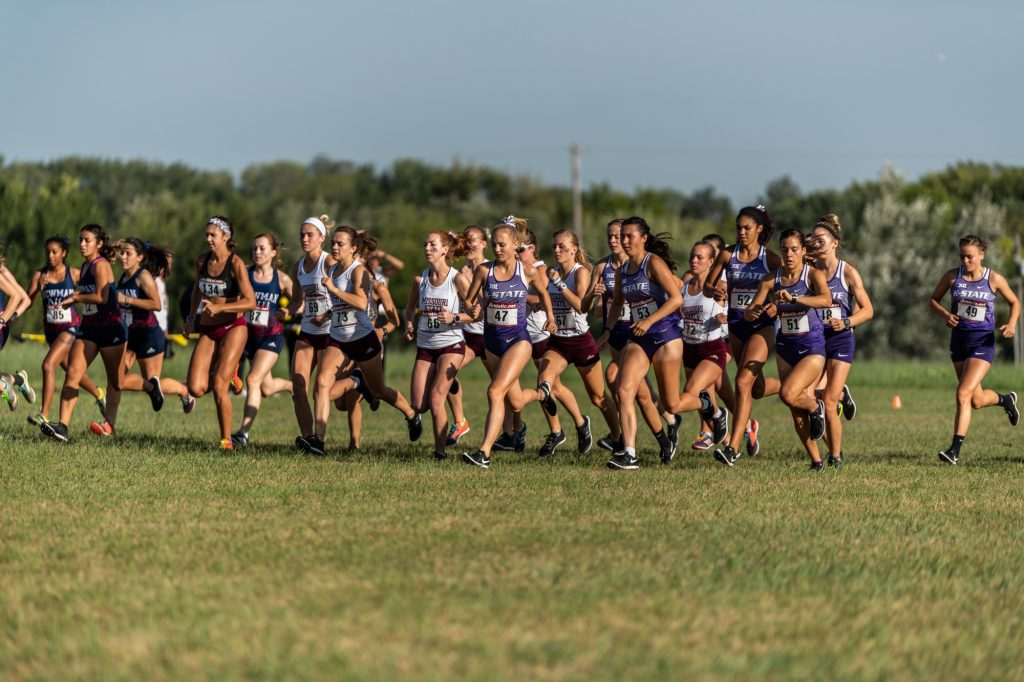 The women's cross country team come off the starting line at the J.K. Gold Classic in Augusta, KS on September 1, 2018. (Alex Todd | Collegian Media Group)