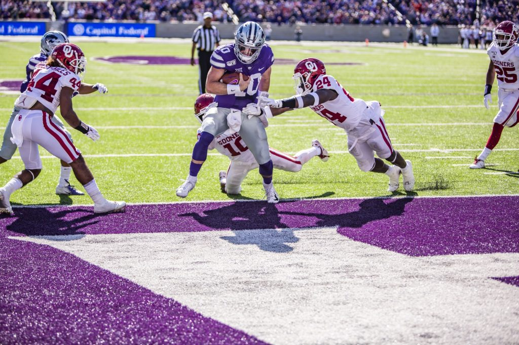 Junior quarterback Skylar Thompson runs in a touchdown during K-State's 48-41 upset victory over No. 5 OU at Bill Snyder Family Stadium on Oct. 26, 2019. (Logan Wassall | Collegian Media Group)