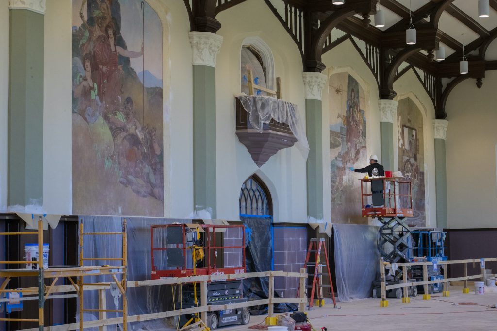 The historic murals in the Great Room of Hale Library were badly damaged in the fire, but Rachel Gilberti and her team are working hard to restore them to their former glory. (Dalton Wainscott | Collegian Media Group)