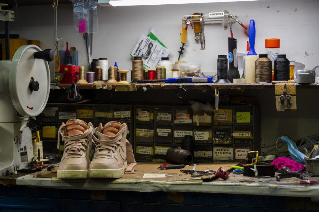 A pair of shoes await mending treatment.