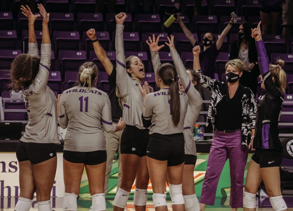 The Kansas State Volleyball team celebrates after their victory against Iowa State at Bramlage Coliseum on Sept. 26, 2020. (Sophie Osborn | Collegian Media Group)
