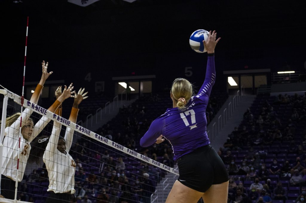 Redshirt junior defensive specialist Brynn Carlson hits the ball over the net while Texas players attempt to block the spike during the game on Oct. 17, 2020. The Wildcats lost to No. 1 Texas in the second game of the series, 3-0. (Dalton Wainscott I Collegian Media Group).