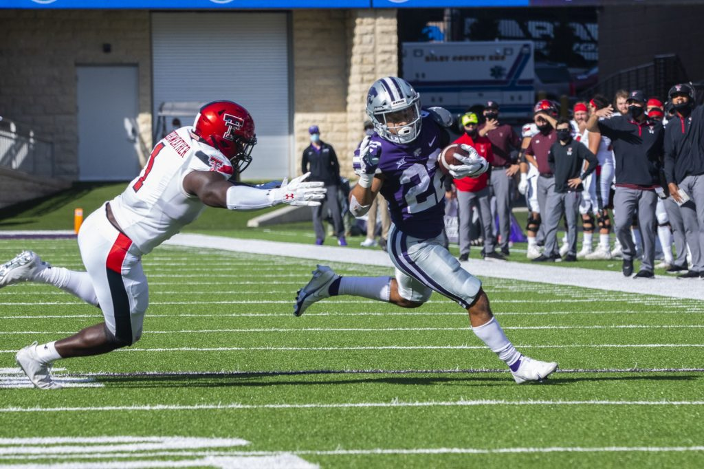 Freshman running back Deuce Vaughn outruns Texas Tech defender for a touchdown in the first half of the football game against Texas Tech on Oct. 3, 2020. The Wildcats beat the Red Raiders 31-21 on Fort Riley Day in Bill Snyder Family Stadium. (Dalton Wainscott   Collegian Media Group).