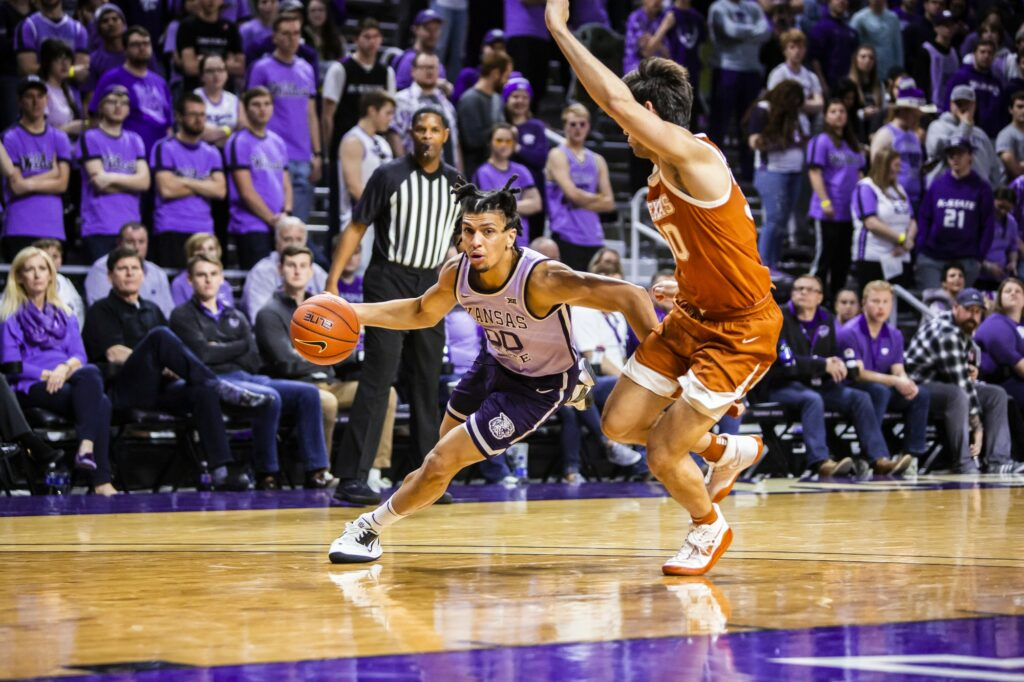 Then junior guard Mike McGuirl charges the basket during K-State's 70-59 loss to Texas earlier this year. (Logan Wassall | Collegian Media Group)