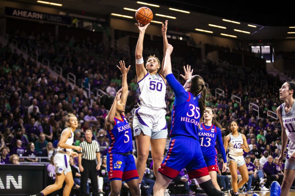 Then freshman center Ayoka Lee leaps up for a shot during K-State's 83-63 victory over Kansas earlier this year. (Logan Wassall | Collegian Media Group)