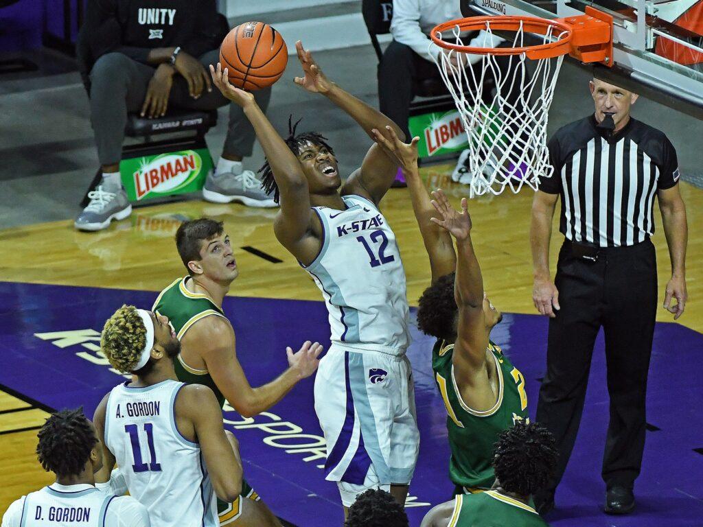 K-State sophomore forward Carlton Linguard Jr. battles for a basket against Jacksonville last Monday. (Photo Courtesy of Scott Weaver)