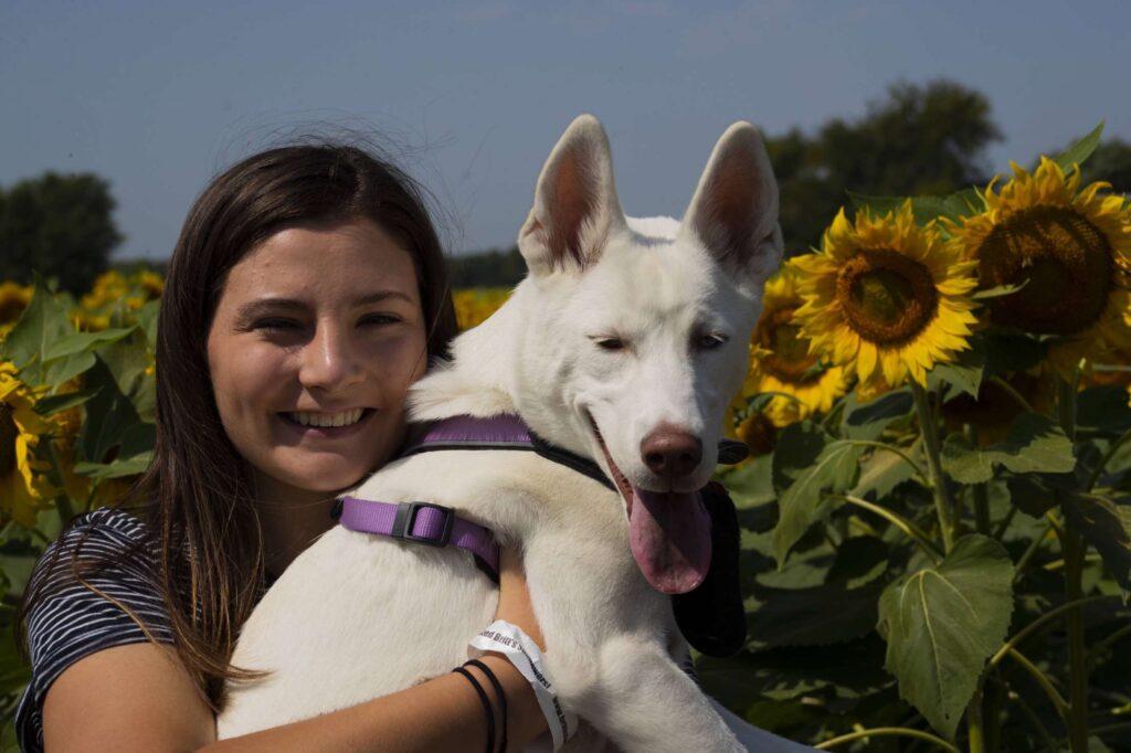 Bailey holds her dog Olive at Britt's Garden Acres. (Dalton Wainscott | Collegian Media Group)