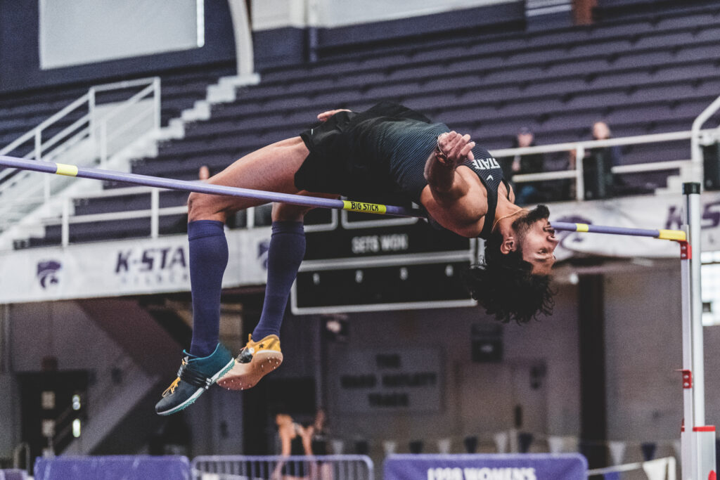 Curling over the crossbar, K-State senior Tejaswin Shankar successfully places first in the mens high jump at 2.12m during the Carol Robinson/Attila Zsivoczky Pentathlon in Ahern Field House in December 2018. (Alex Todd   Collegian Media Group)
