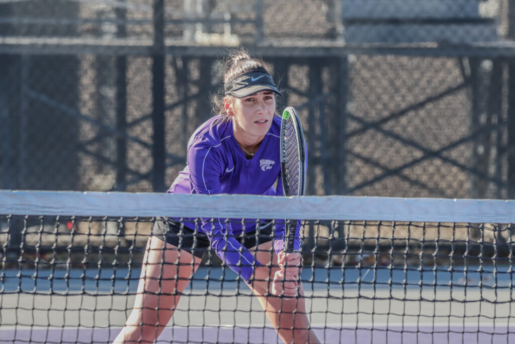 At the net, junior Ioana Gheorghita watches for the tennis ball at the K-State Fall Invitational on Oct. 30. (Macey Franko | Collegian Media Group)