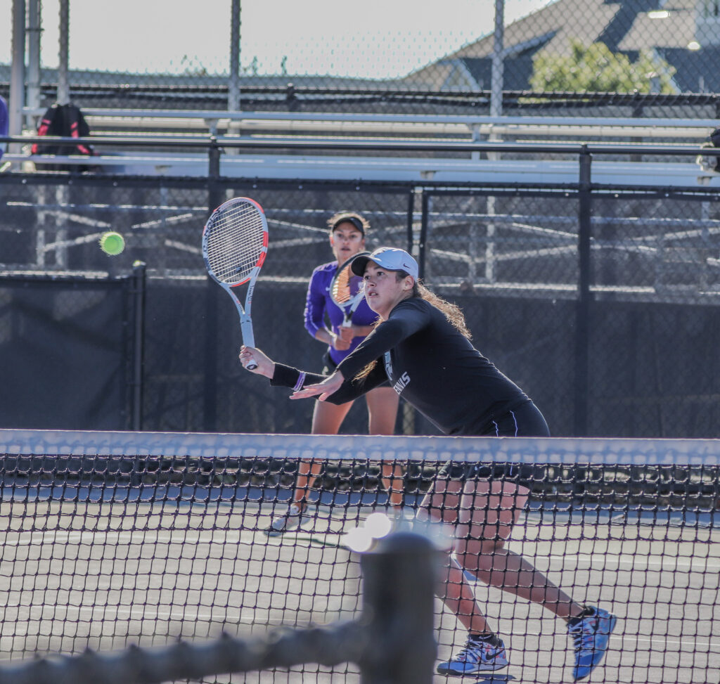 About to hit the ball, junior Maria Linares moves her tennis racket in her first match of the day during the K-State Fall Invite on Oct. 31, 2020. (Macey Franko | Collegian Media Group)