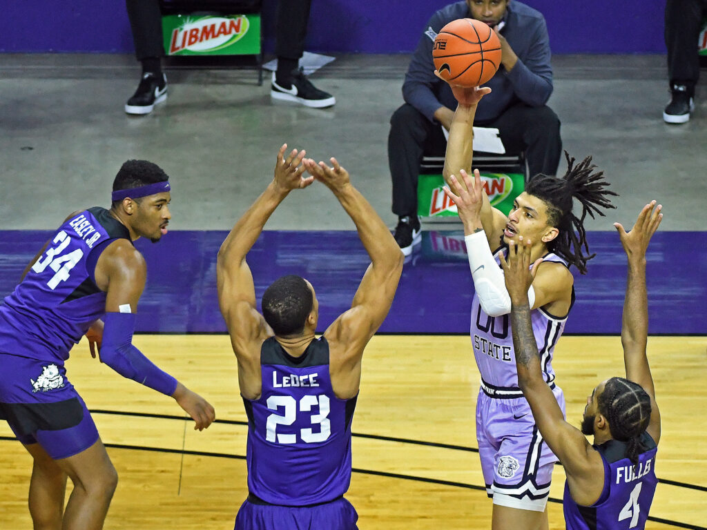 K-State senior Mike McGuirl attempts a shot while being triple teamed in the Wildcat's 67-60 loss to TCU on Saturday. (Photo Courtesy of Scott Weaver)