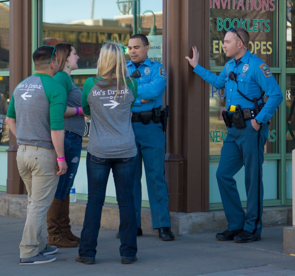 Police officers talk with Fake Patty's Day goers during Fake Patty's Day celebration in Aggieville on Mar. 7, 2015. (Archive photo by Cassandra Nguyen    Collegian Media Group)