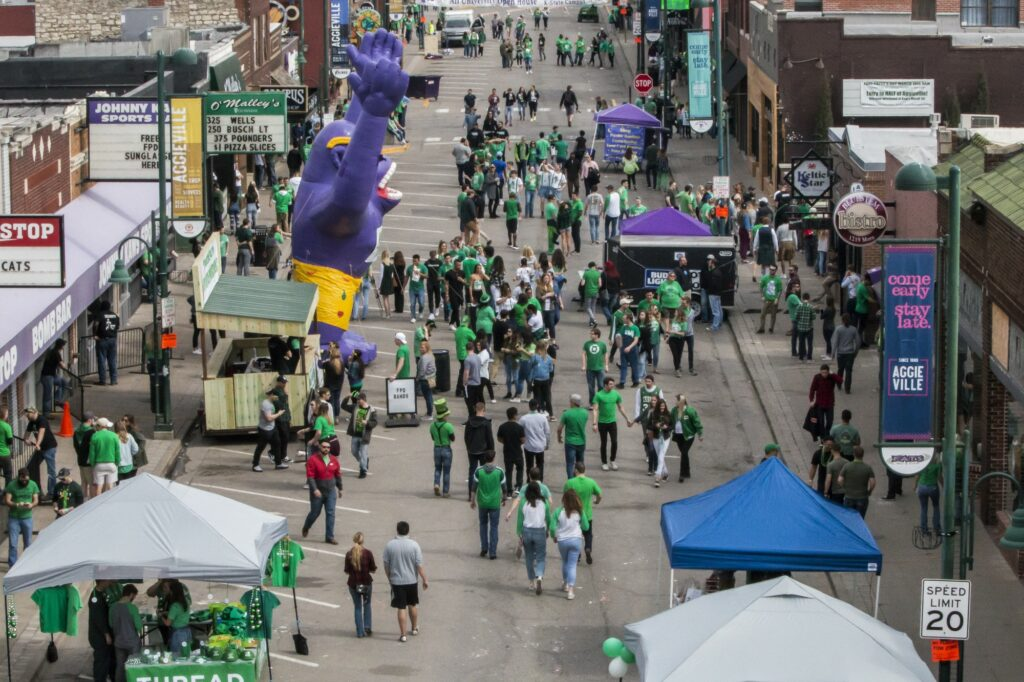 Citizens from Manhattan and surrounding areas come to Aggieville to celebrate Fake Patty's Day with their family and friends. With games, food, and music, there are plenty of things to keep people coming. (Archive photo by Logan Wassall   Collegian Media Group)