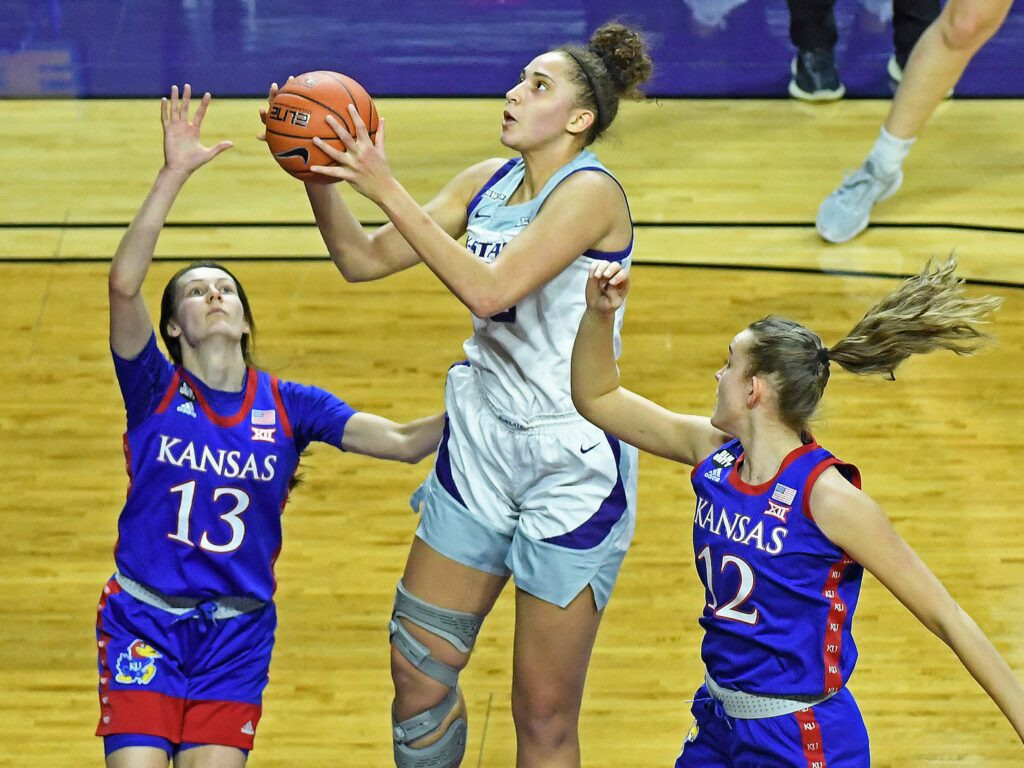 K-State sophomore Ayoka Lee goes up for a shot against Kansas on Saturday in Bramlage Coliseum. The Wildcats won the game, 77-66. (Image courtesy of Scott Weaver | K-State Athletics)