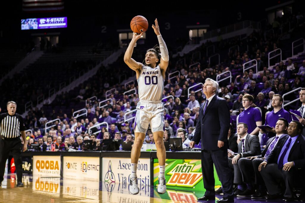 Junior guard Mike McGuirl leaps up for a shot during K-State's 64-59 loss to Oklahoma State in Bramlage Coliseum on Feb. 11, 2020. (Logan Wassall | Collegian Media Group)
