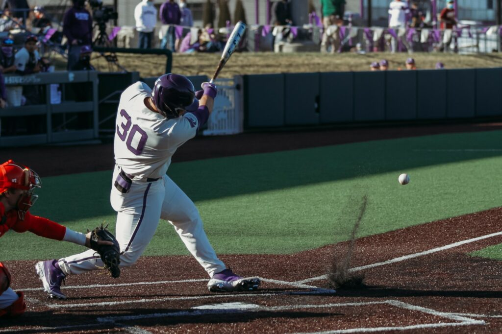 Senior catcher Chris Ceballos swings through after hitting the ball during K-State's 6-4 loss to New Mexico on Saturday at Tointon Family Stadium. (Sophie Osborn | Collegian Media Group)