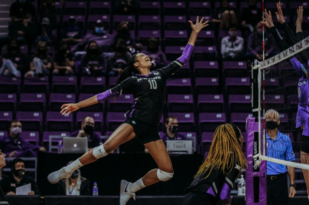 Freshman outside hitter Jayden Nembhard stretches out to tap a ball over the net during the March 20, 2021 senior night game against Creighton at Bramlage Coliseum. (Sophie Osborn | Collegian Media Group)