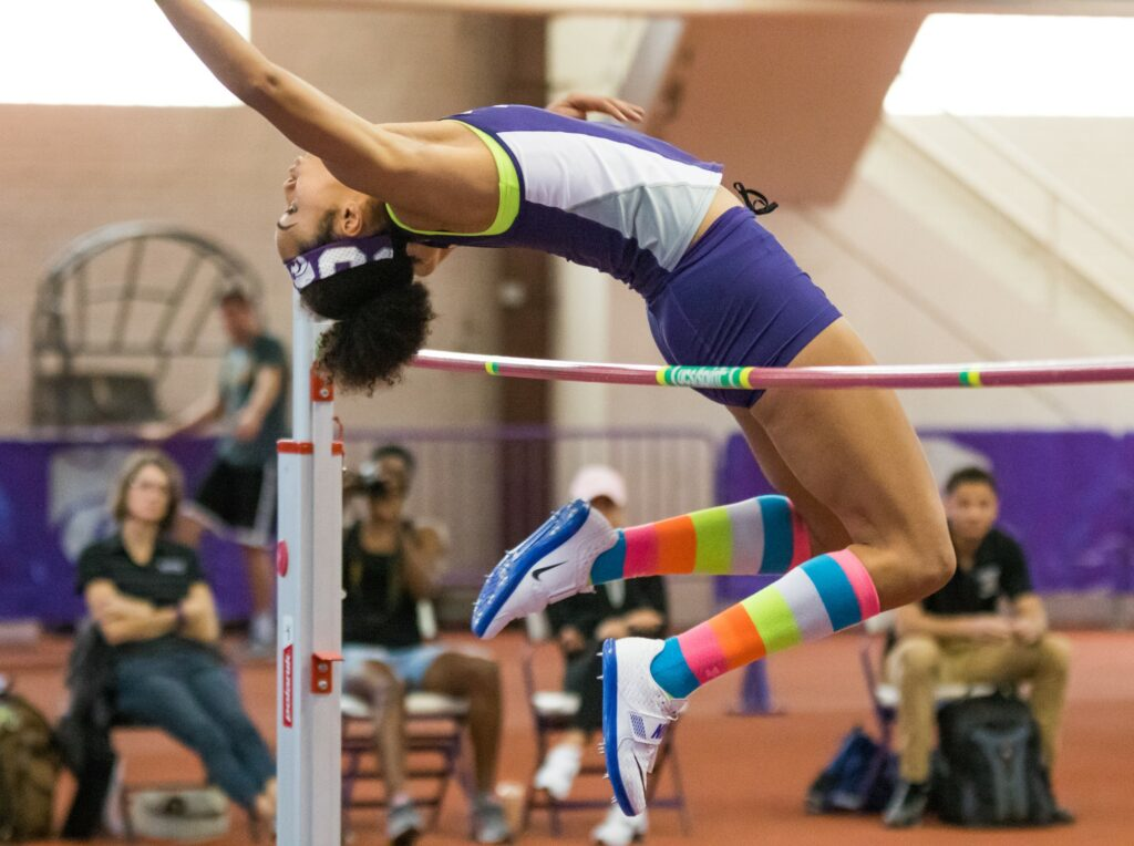 Senior Ariel Okorie jumps in the high jump event at the K-State track meet in Ahearn Field House on Feb. 17, 2017. (John Benfer | The Collegian)
